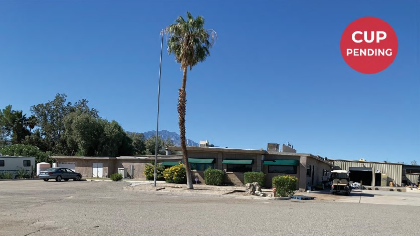 a wide photo showing the tree in front of the property in 52368 sf proposed cannabis facility