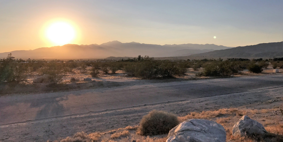 a photo of mountain view with a sunset in 59.62 acres land in bennet road sky valley california